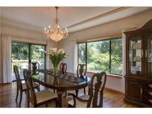 Dining room with big window and deck connected to formal living