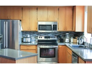 Beautiful kitchen with new countertops, backsplash, and ceramic